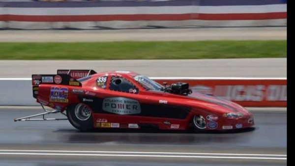 A 2013 Monte Carlo dragster racing on the track