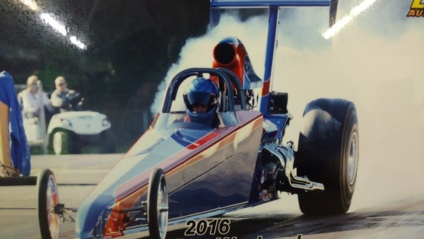 2015 American Dragster burning out before a race