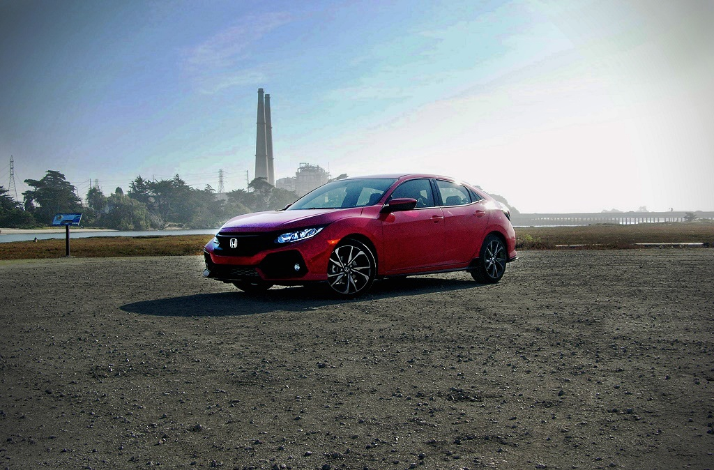 The 2016 Honda Civic Hatchback in red.