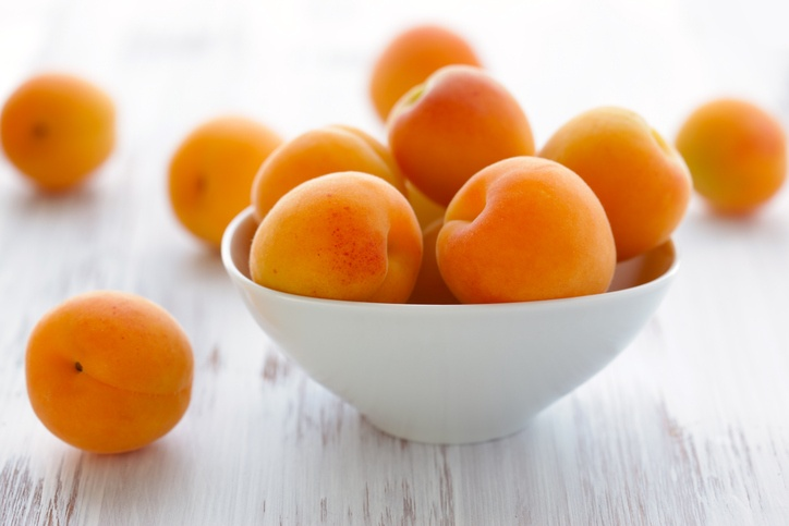 ceramic bowl filled with apricots