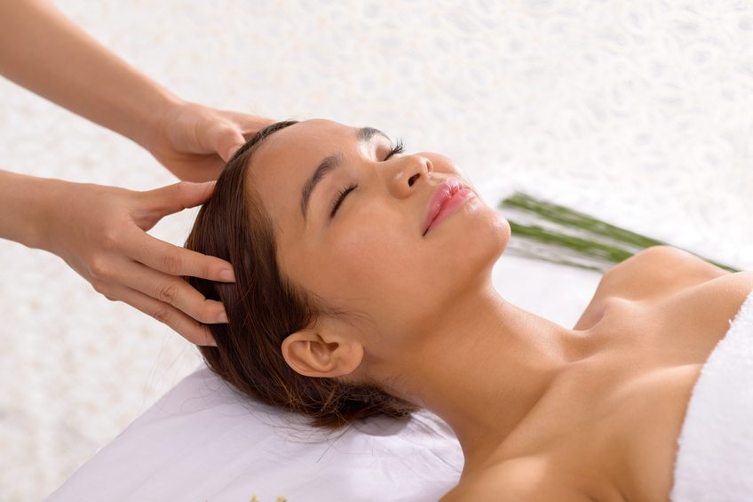 young woman enjoying scalp massage