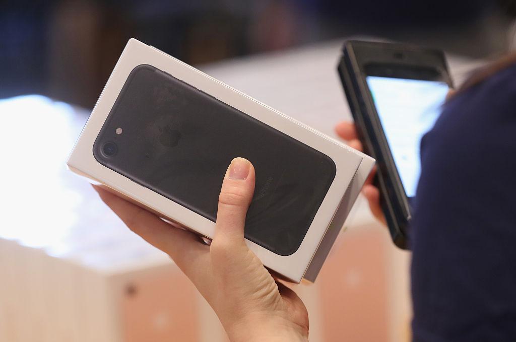 An Apple employee prepares Apple iPhone 7 phones