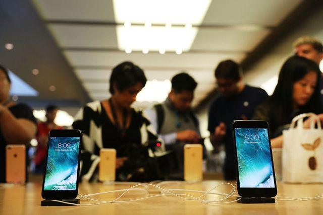 The new iPhone 7 and the 7 Plus are displayed on a table at an Apple store