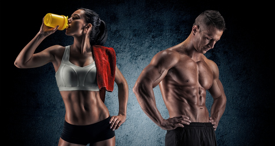 Athletic man and woman show off their abs