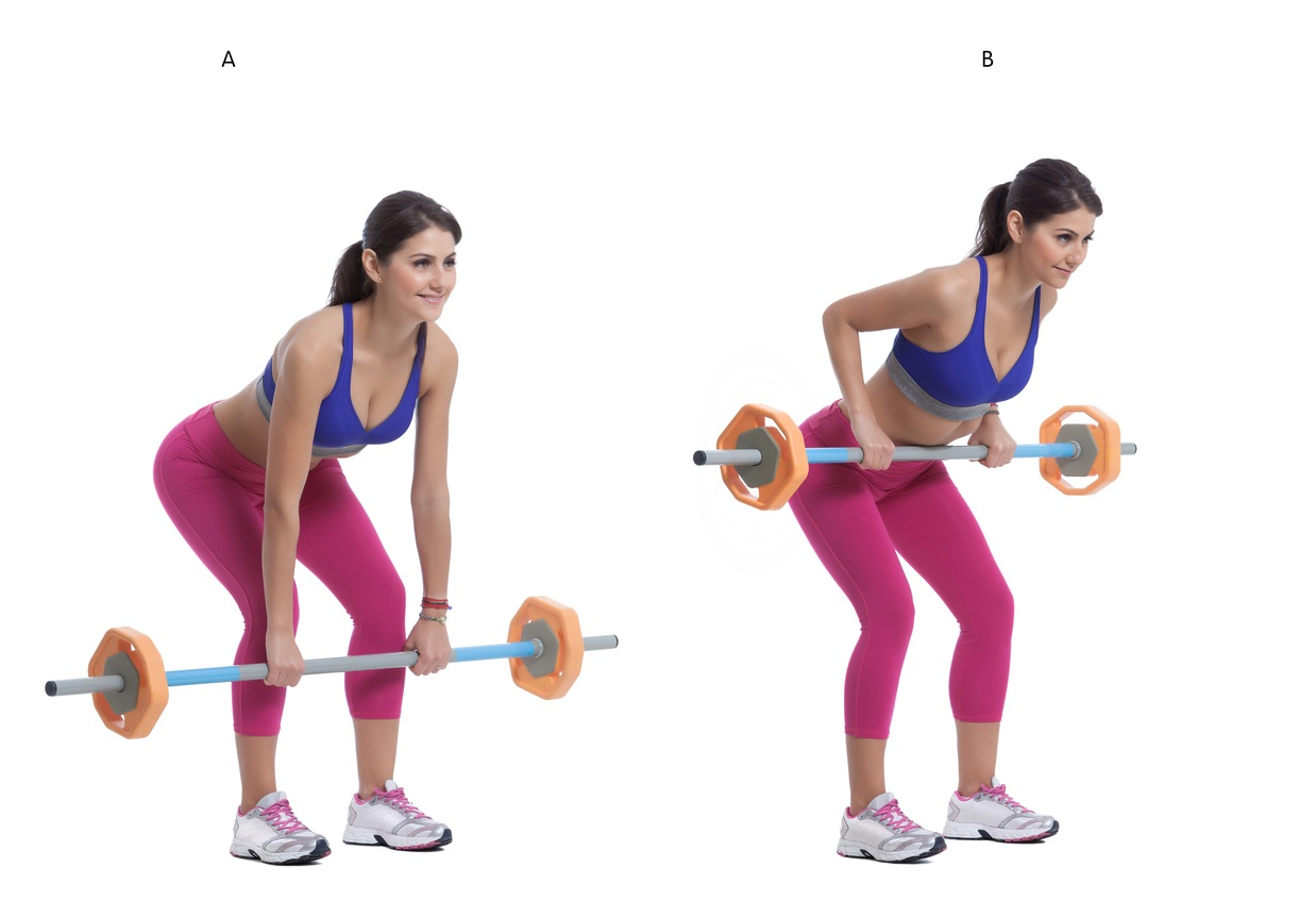 A woman does barbell rows
