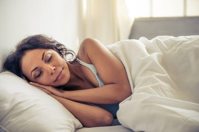 young woman smiling while sleeping