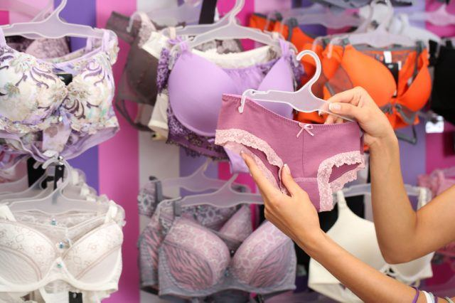 Young woman shopping for underwear
