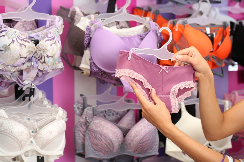young woman in shop with underwear