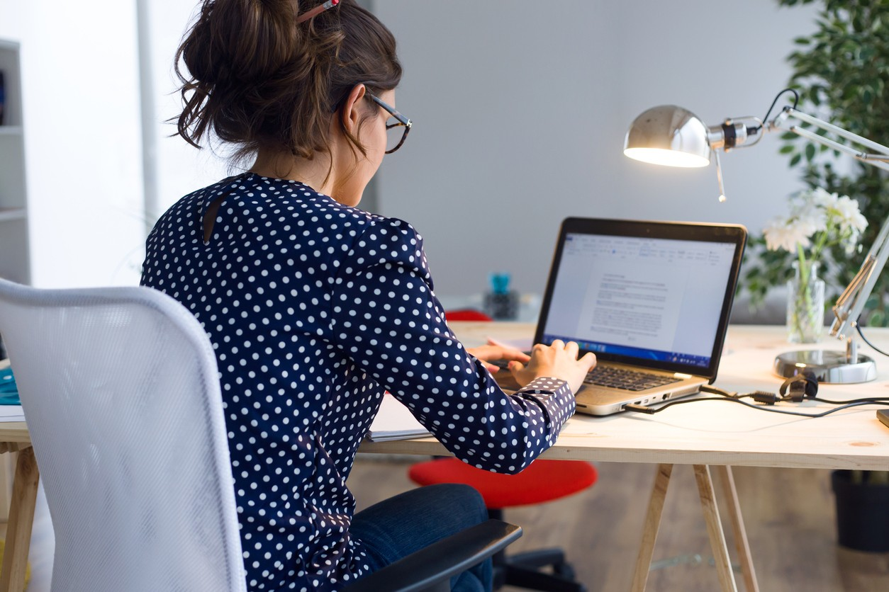 young woman working with laptop