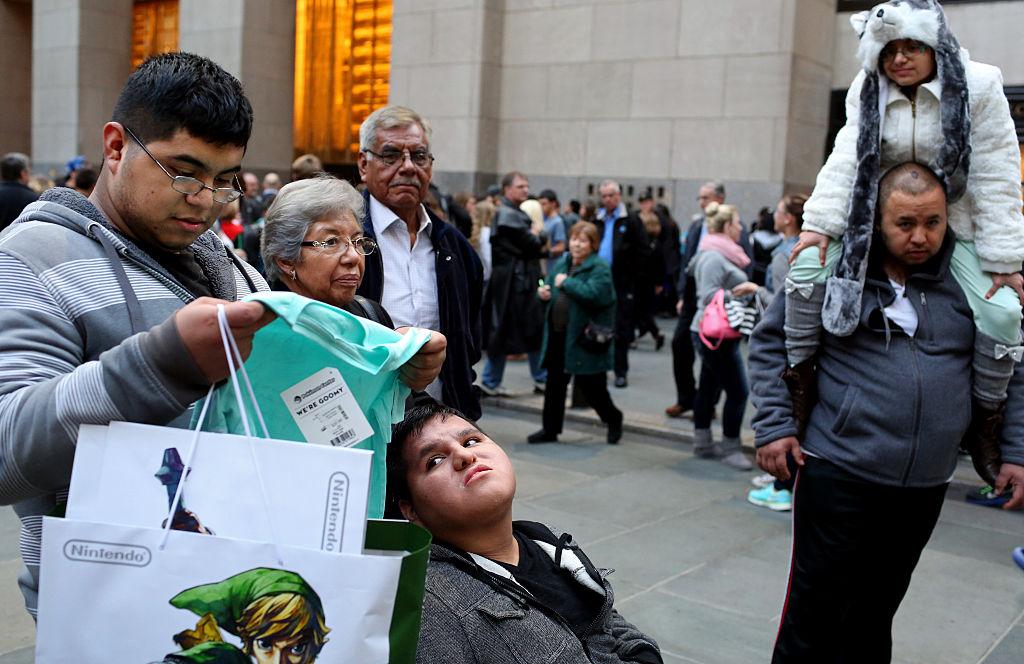 Shoppers walk through Rockefeller Center in New York City