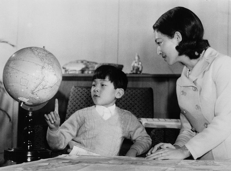 A young Prince Hiro, aka Crown Prince Naruhito of Japan, studying a globe with his mother and pointing out future hot spots for job seekers