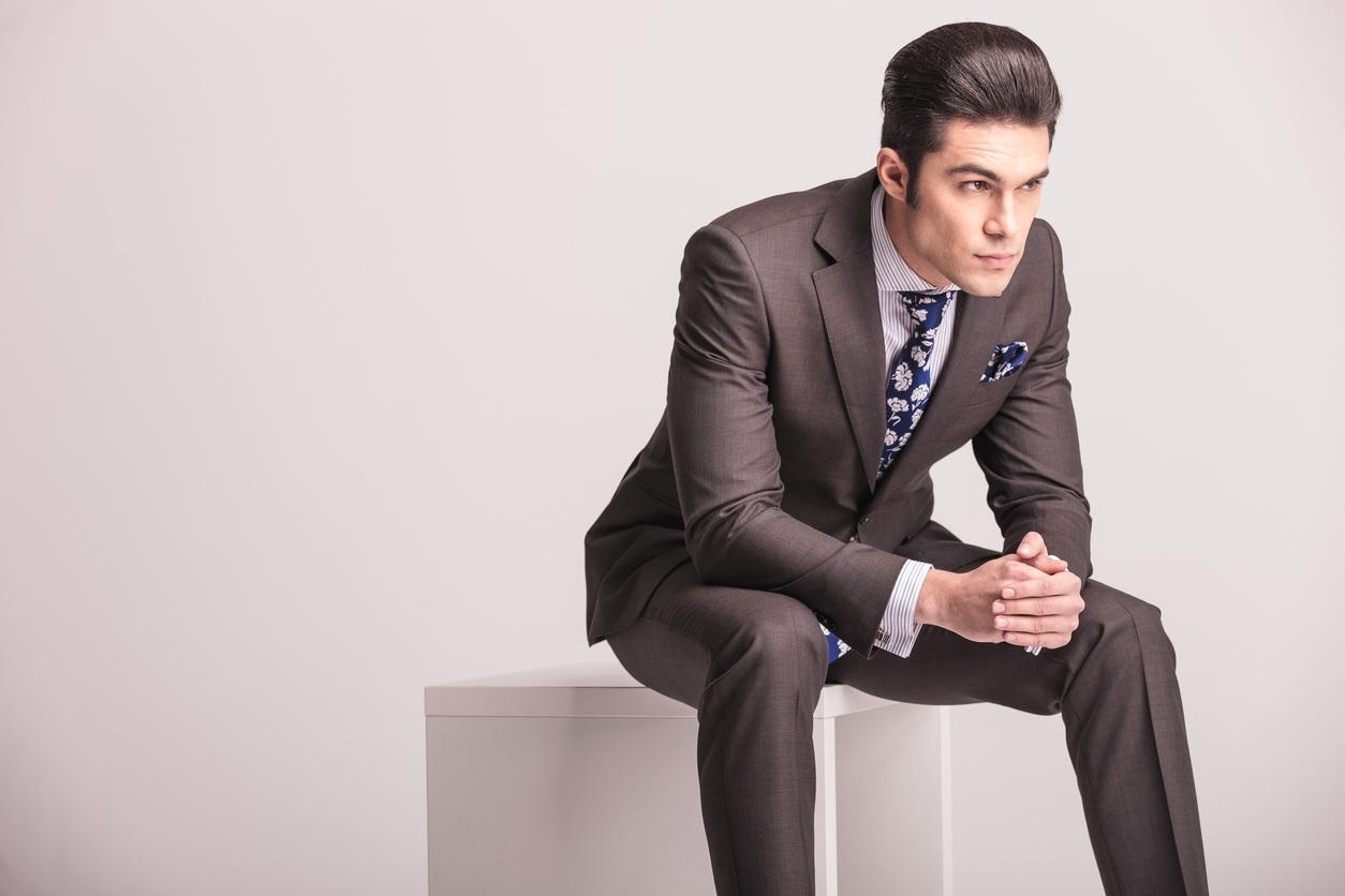 businessman sitting on a white modern chair