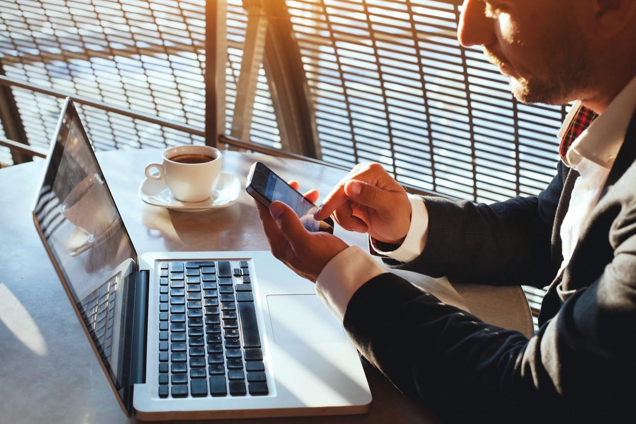 business man using internet on smart phone
