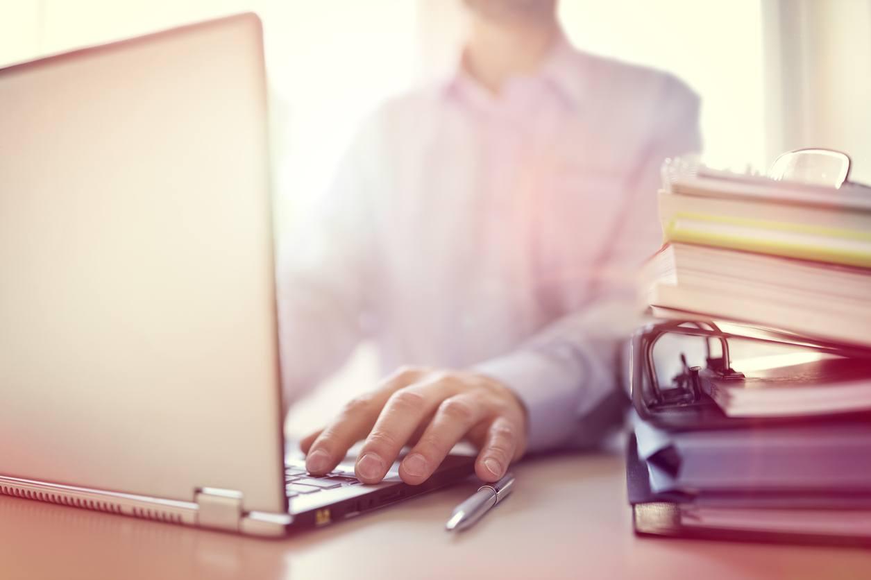 Businessman or designer using laptop computer