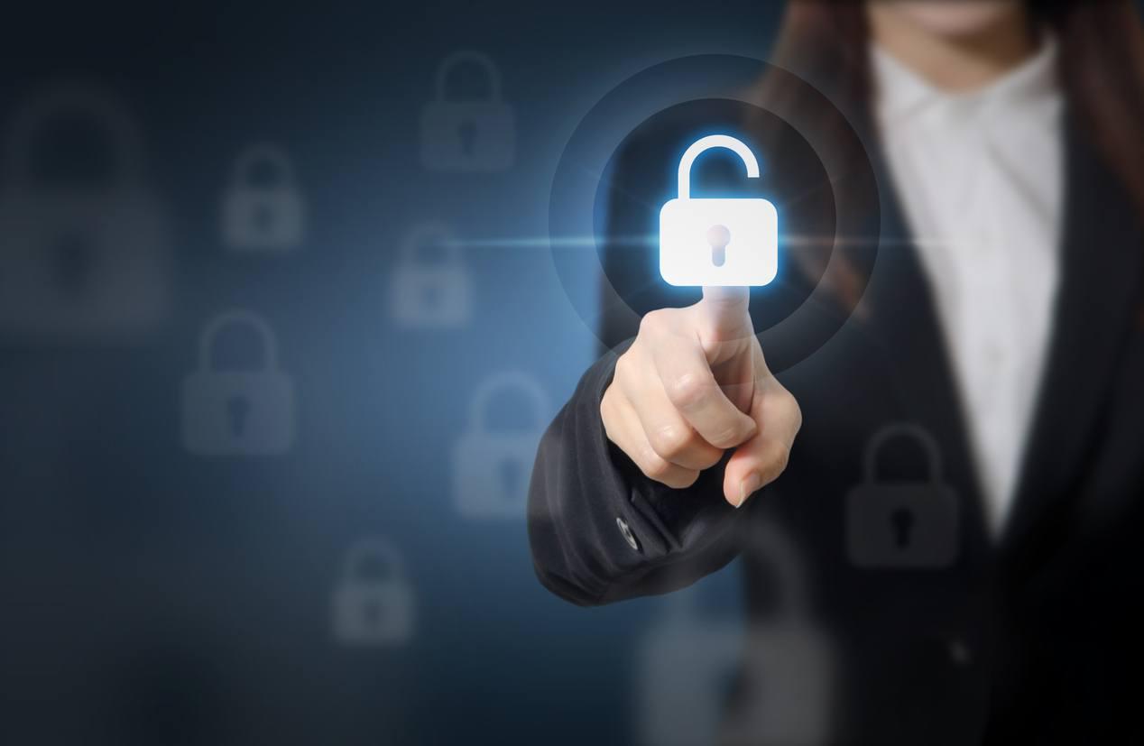 Businesswoman pressing unlocking on virtual screens