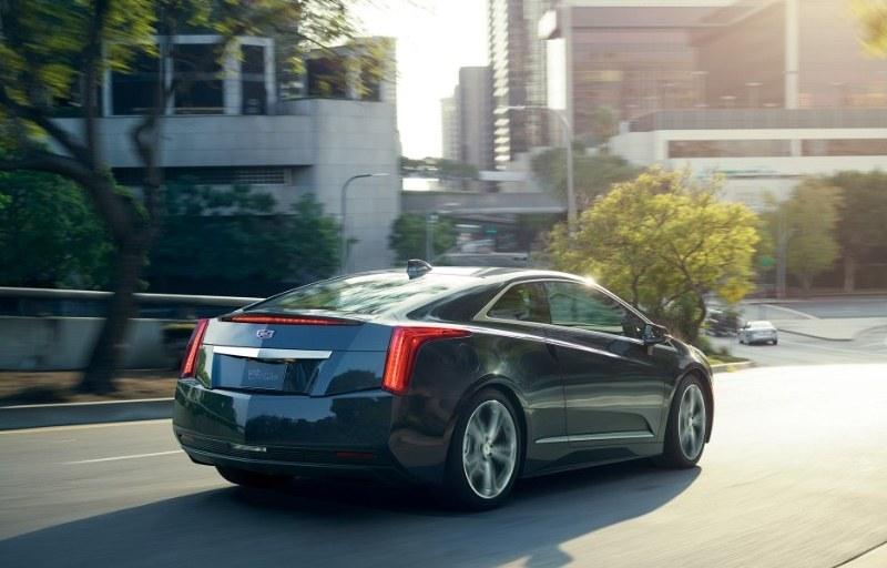 plug in cadillac luxury hybrid slide drive test review sedan