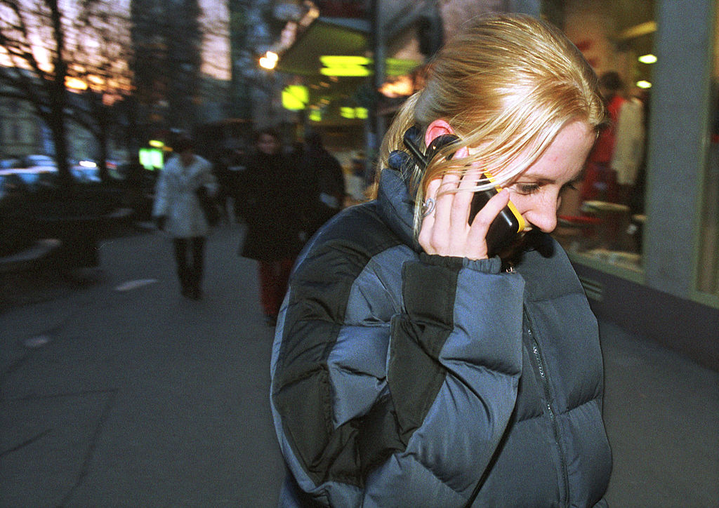 A teenage girl talks on her GSM mobile phone January 26, 2001 in central Prague, Czech Republic