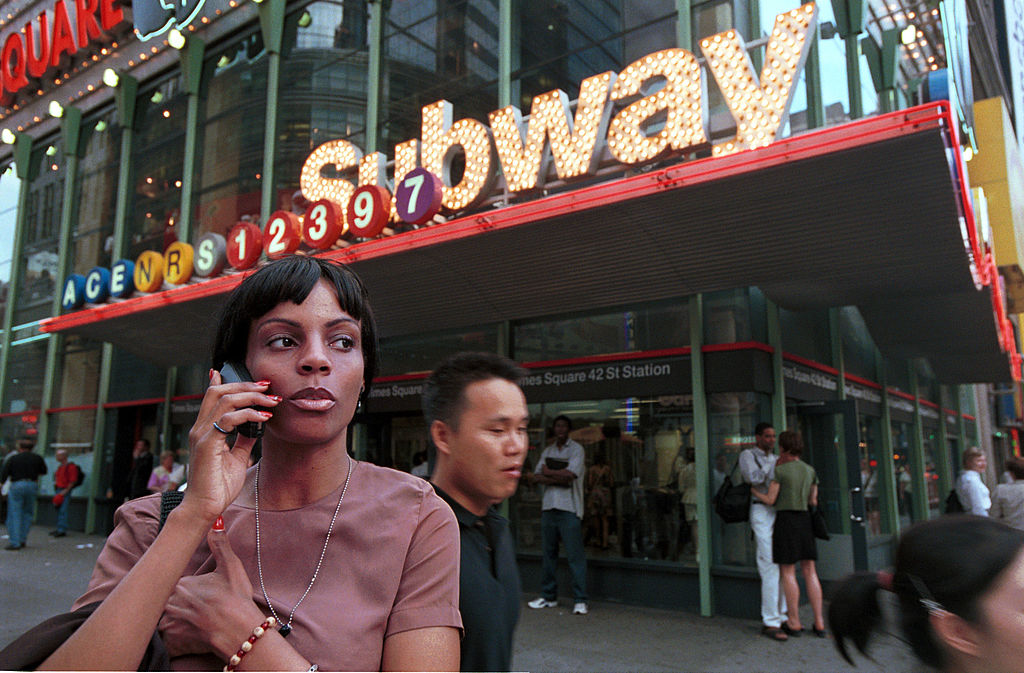 A woman speaks on a cellular phone in Times Square July 17, 2000 in New York