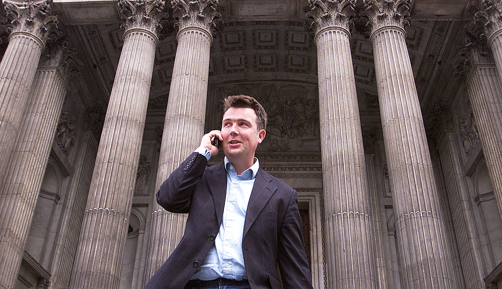 An unidentified businessman uses his cell phone May 22, 2002 in London, England