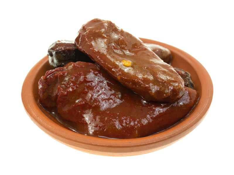 A small dish with chipotle peppers in adobo sauce