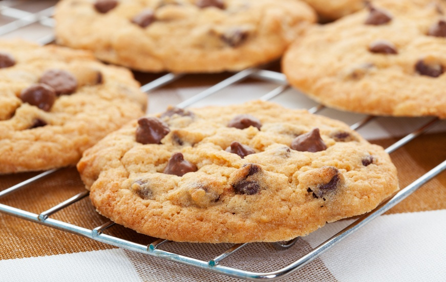 Warm, golden brown, chocolate chip cookie
