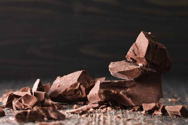 chocolate pieces on a dark wooden