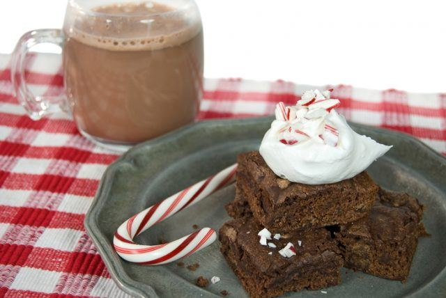 Cup of hot chocolate and brownie with candy cane