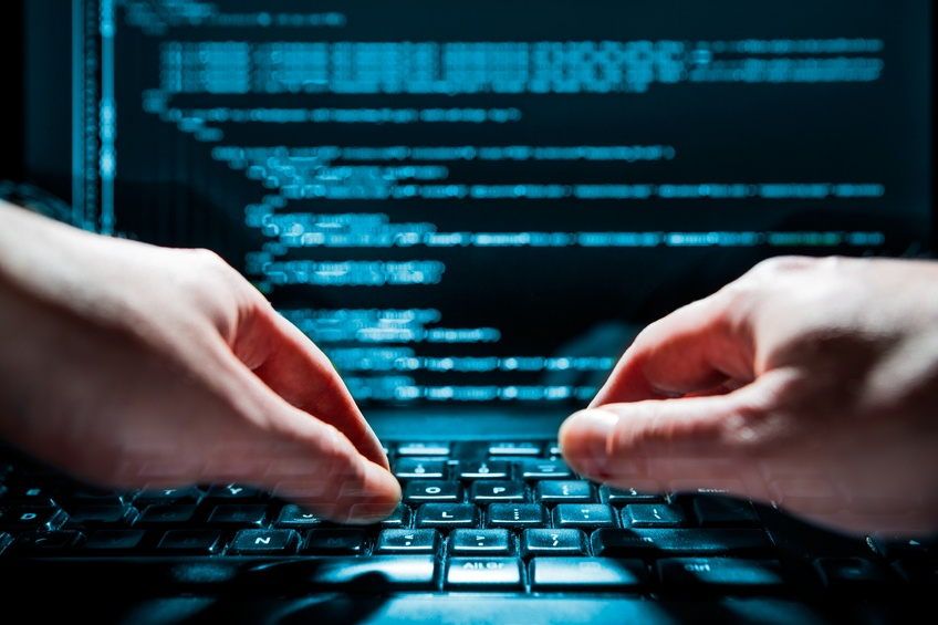 man using laptop to code