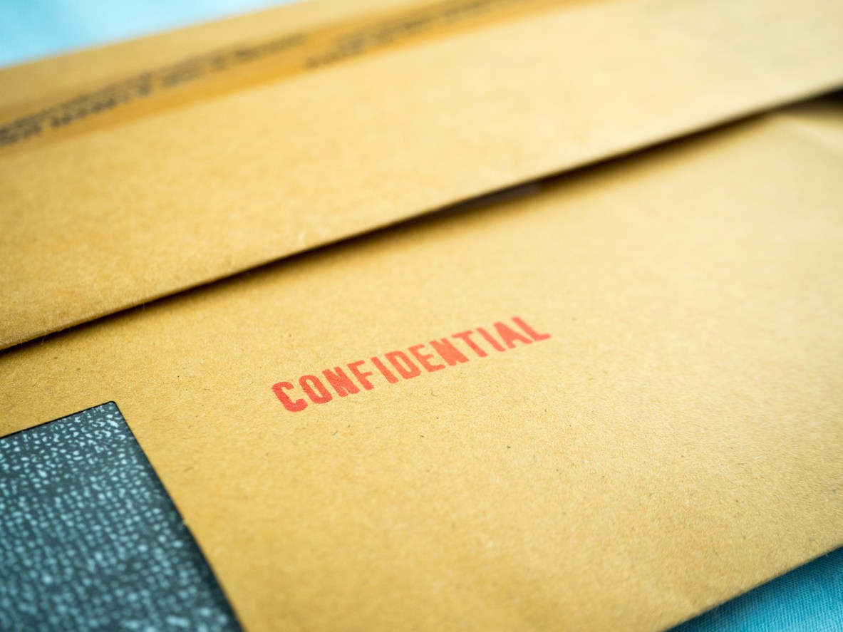 """Confidential"" printed on brown vintage envelope"