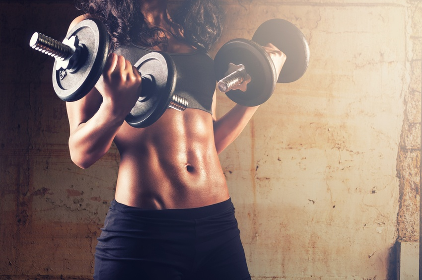 woman holding dumbbells in each hand