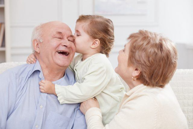 Pretty old men and women are spending time with their granddaughter