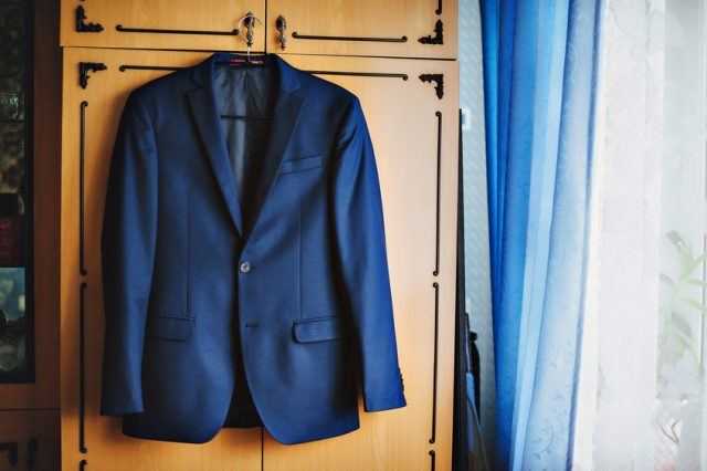 Dark blue in a small checkered formal men suit