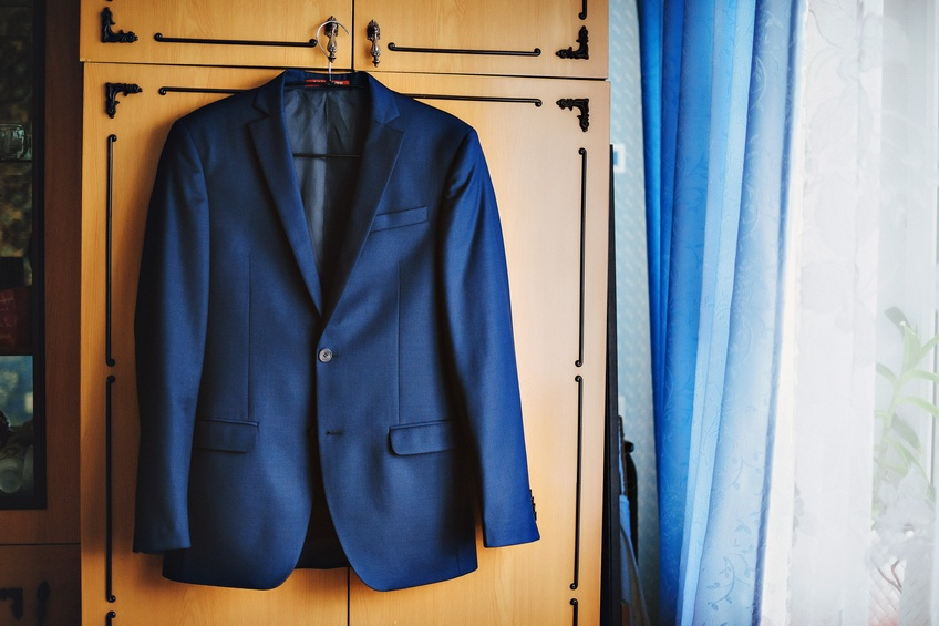 blue suit jacket on a hanger