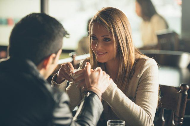 couple at the bar having a coffee