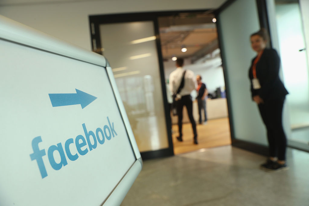A sign points to the Berlin Facebook offices