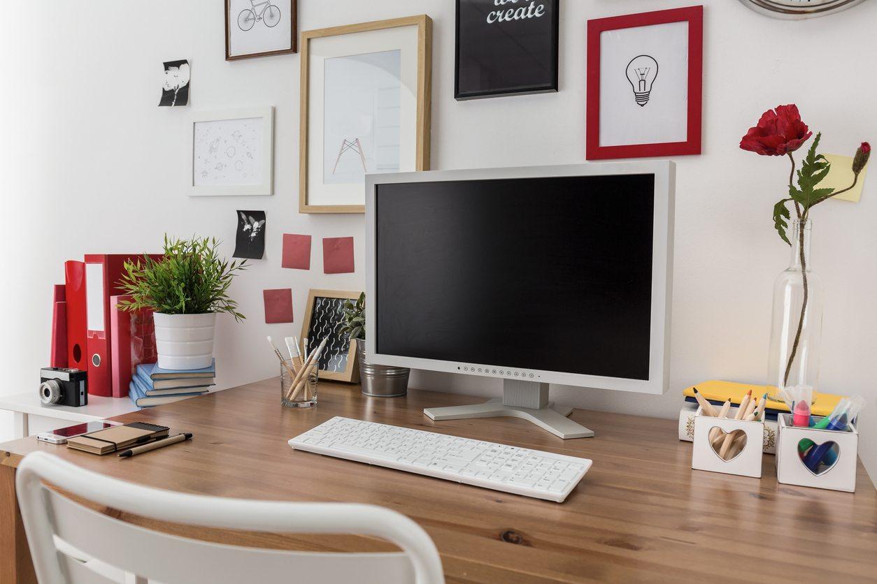 desktop computer on wooden desk