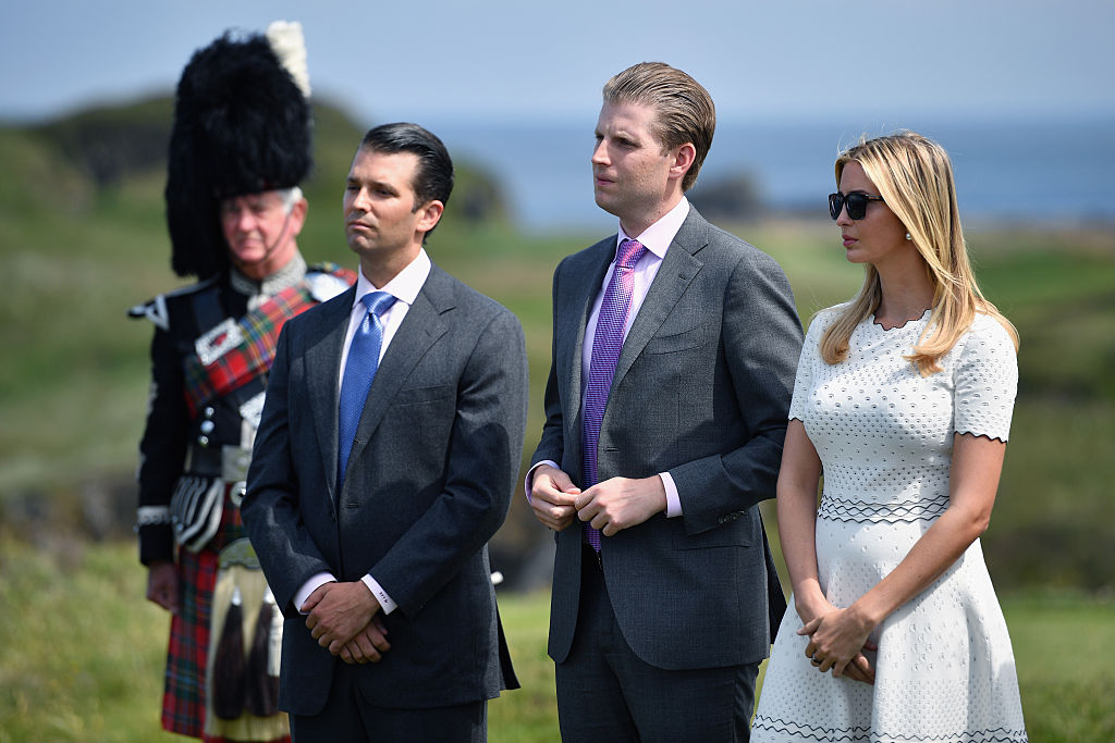 Donald Trump junior, Eric Trump and Ivanka Trump listen to their father