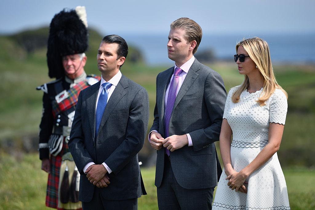 Donald Trump junior, Eric Trump and Ivanka Trump listen to their father