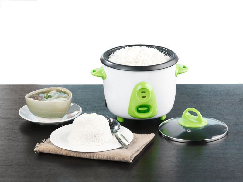 Electric rice cooking and steaming pot