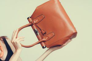 Your Purse Is Seriously Hurting Your Health — Here's What You Need to Do