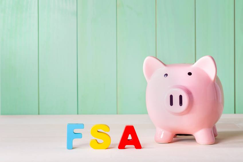 Flexible Spending Account FSA concept with pink piggy bank