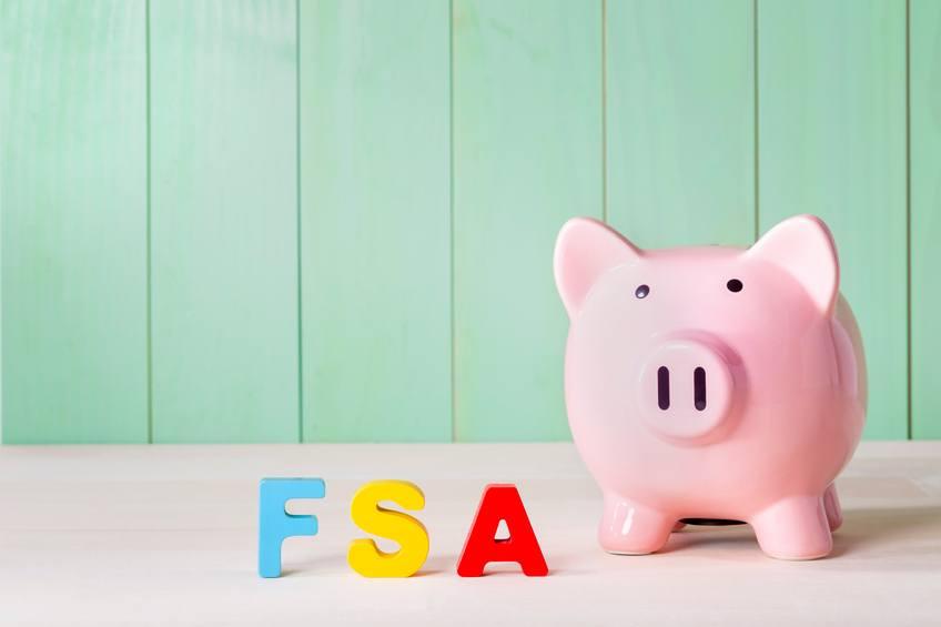 Flexible Spending Account FSA concept with pink piggy bank