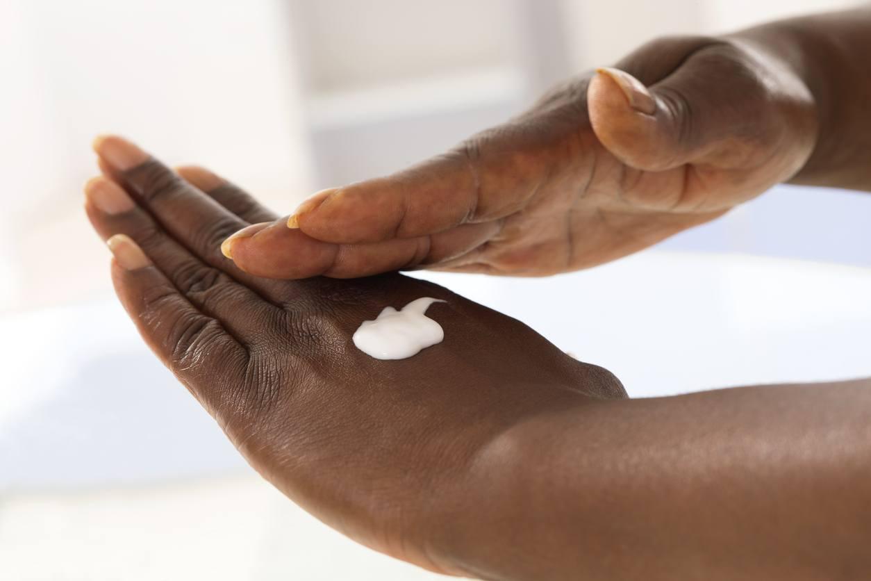 female hand applying moisturiser