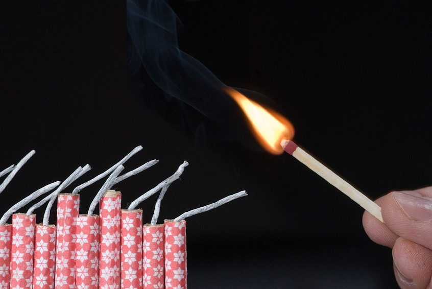 lit with flame of match with fireworks