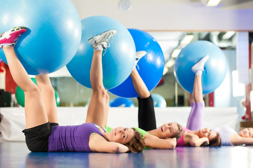 Women working out with stability balls