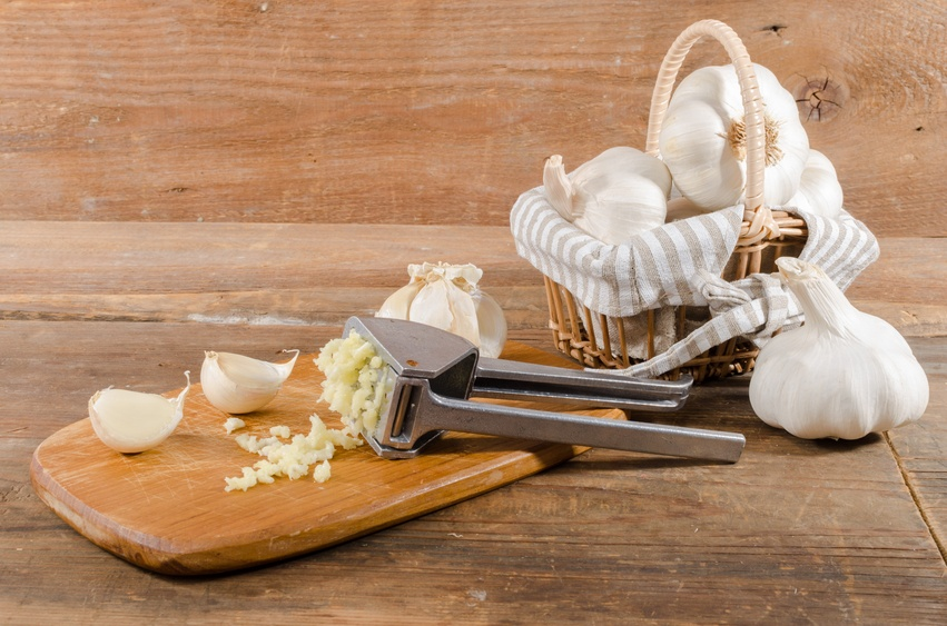 crushed garlic on wooden background