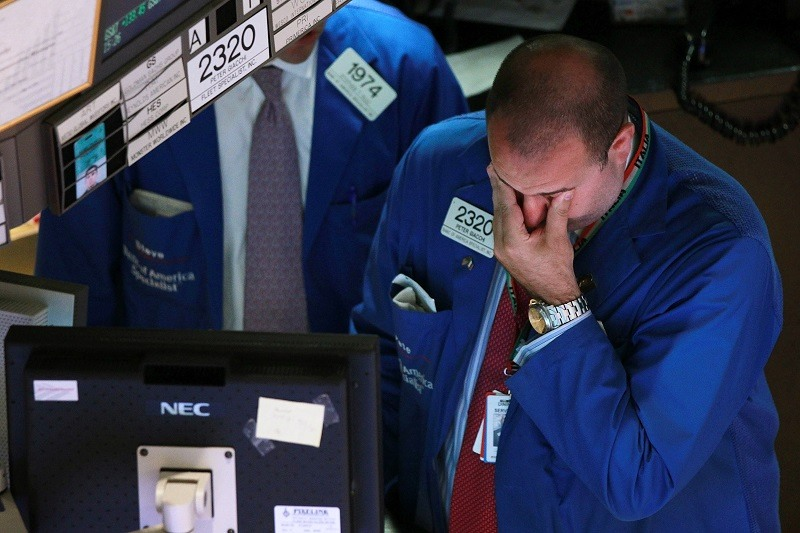 A trader works on the floor of the New York Stock Exchange during the height of the Great Recession