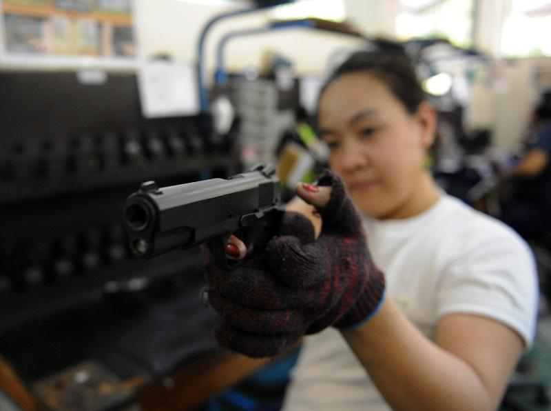 A worker at a gun manufacturing facility, one of the jobs mentioned in the report