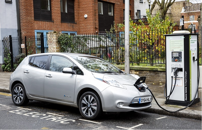 Go Ultra Low Nissan LEAF on charge on a London street. Ultra-low emission vehicles such as this can cost as little as 2p per mile to run and some electric cars and vans have a range of up to 700 miles.