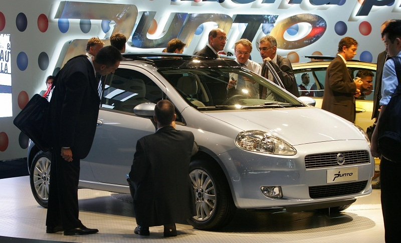 FRANKFURT/MAIN, Germany: Fair goers inspect a Fiat Punto car on 13 September 2005 in Frankfurt/Main at the 61st International motor show (IAA), scheduled from 12 to 25 September. About one million people are expected to visit the fair where about a thousand exhibitors from 44 countries present their cars.